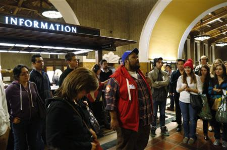 """A member of the L.A. Dance Project portraying Marco Polo (in red jacket) performs the opera """"Invisible Cities"""" at Amtrak's Union Station in Los Angeles November 15, 2013. REUTERS/Fred Prouser"""