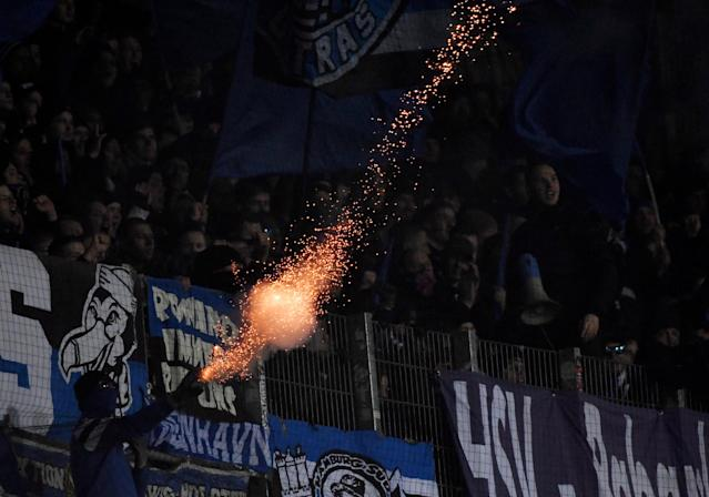 Soccer Football - Bundesliga - Werder Bremen vs Hamburger SV - Weser-Stadion, Bremen, Germany - February 24, 2018 Hamburg fans let off fireworks REUTERS/Fabian Bimmer DFL RULES TO LIMIT THE ONLINE USAGE DURING MATCH TIME TO 15 PICTURES PER GAME. IMAGE SEQUENCES TO SIMULATE VIDEO IS NOT ALLOWED AT ANY TIME. FOR FURTHER QUERIES PLEASE CONTACT DFL DIRECTLY AT + 49 69 650050 TPX IMAGES OF THE DAY