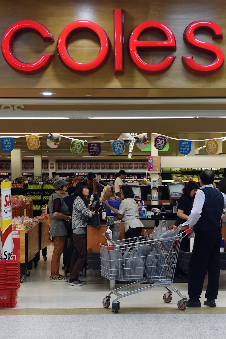 Shoppers queue at the registers at a Coles supermarket in Sydney. Source: AAP