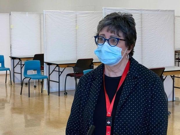Gurnham came out of retirement as a nurse to help manage a COVID-19 vaccination clinic.