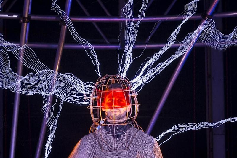 """Magician David Blaine stands inside an apparatus surrounded by a million volts of electric currents streamed by tesla coils during his 72-hour """"Electrified: 1 Million Volts Always On"""" stunt on Pier 54, Friday, Oct. 5, 2012, in New York. The stunt, sponsored by Intel, is the latest of daredevil endeavors by the magician whose previous stunts included being encased in ice for over 60 hours in Times Square. (AP Photo/John Minchillo)"""
