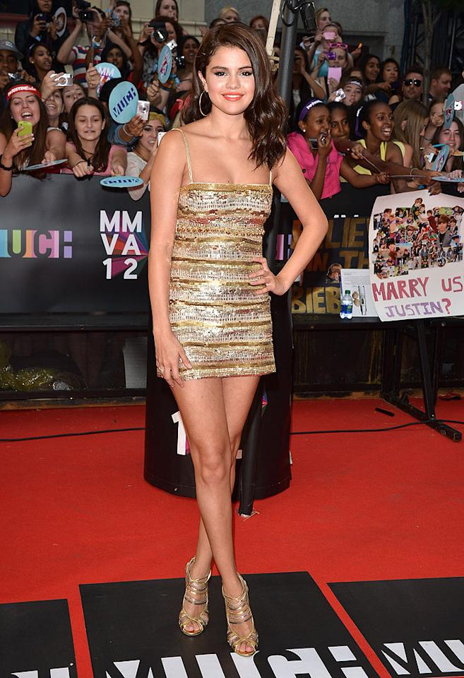 We're not feeling her orange lipstick, but other than that, we must say that Selena Gomez killed it on the red carpet at the Toronto-set MuchMusic Awards on Sunday night. Yes, she was showing quite a bit of skin in the spaghetti-strapped Roberto Cavalli mini and Jimmy Choo sandals, but ... if you've got it, flaunt it. Right? (6/17/2012)