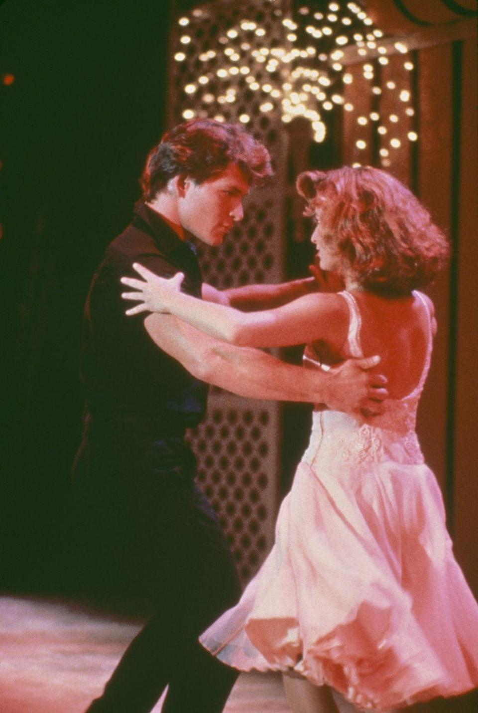 """<p><em>Dirty Dancing</em> premiered in 1987 and the film's hit song """"(I've Had) The Time of My Life"""" became an instant wedding classic. </p>"""