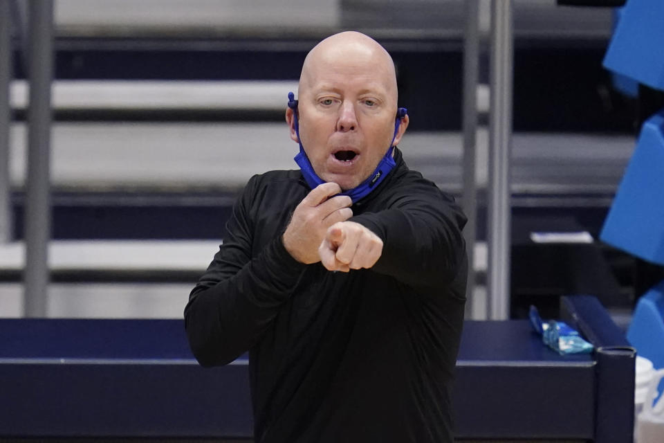 UCLA head coach Mick Cronin gestures against Alabama in the first half of a Sweet 16 game in the NCAA men's college basketball tournament at Hinkle Fieldhouse in Indianapolis, Sunday, March 28, 2021. (AP Photo/Michael Conroy)