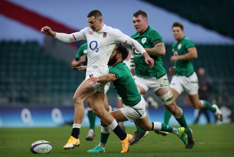 At the double - England wing Jonny May (L) kicks ahead to score his second try against Ireland at Twickenham on Saturday