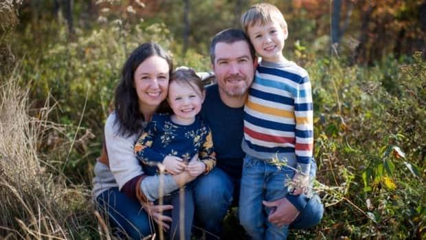 Theresa and Brian Fitzgerald of Quispamsis decide day by day whether to send  their children, Amelia, four, and Colin, seven, to school, based on COVID-19 numbers. (Submitted by Theresa Fitzgerald - image credit)