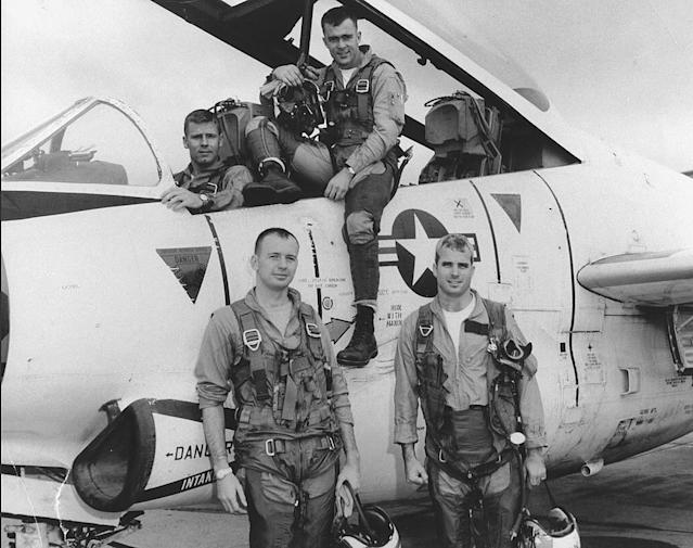 <p>John McCain (bottom right) poses with his U.S. Navy squadron in 1965. (Photo: National Archives/Handout via Reuters) </p>
