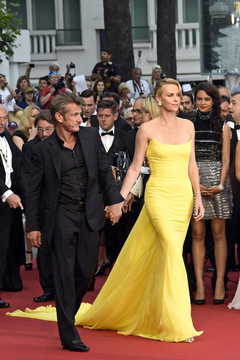 Charlize Theron was among the many stars dressed in bright colors at Cannes this year, here in a lemon yellow gown by Dior Couture.