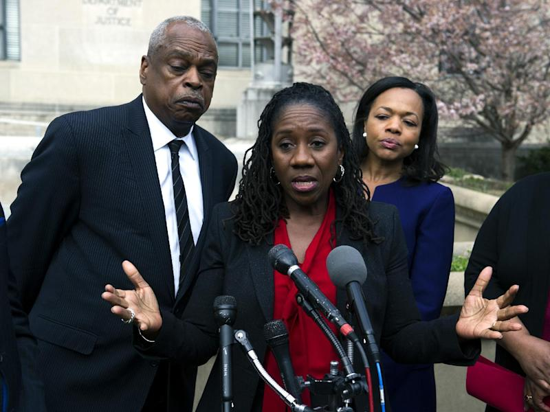 Sherrilyn Ifill, president and director-counsel, NAACP Legal Defense and Education Fund, center, speaks with the news media outside of the Justice Department, as Wade Henderson, president of the Leadership Conference on Civil and Human Rights, left, and Kristen Clarke, The Lawyer's Committee for Civil Rights Under Law, look on following their meeting with Attorney General Jeff Sessions, in Washington, Tuesday, March 7, 2017. (AP Photo/Cliff Owen)