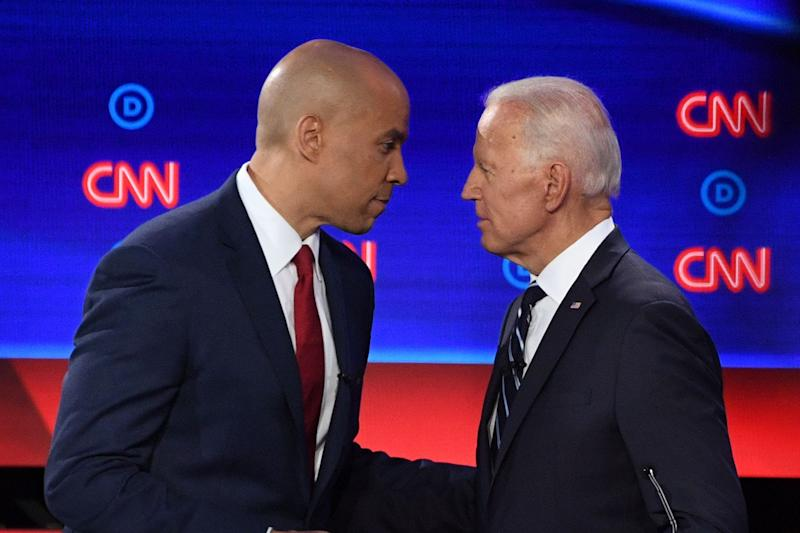 Democratic presidential hopefuls former Vice President Joe Biden and Sen. Cory Booker of New Jersey chat during a break in the second round of the second Democratic primary debate of the 2020 presidential campaign season hosted by CNN at the Fox Theatre in Detroit, Michigan on July 31, 2019.