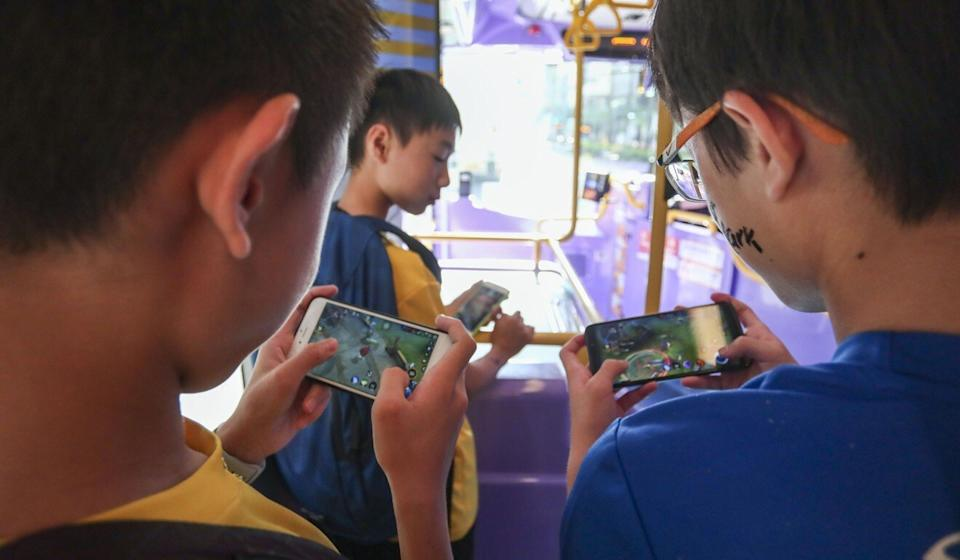 Largely trapped at home and being forced to switch to online learning due to Covid-19, many students saw their screen time leap dramatically in the past year. Photo: AFP