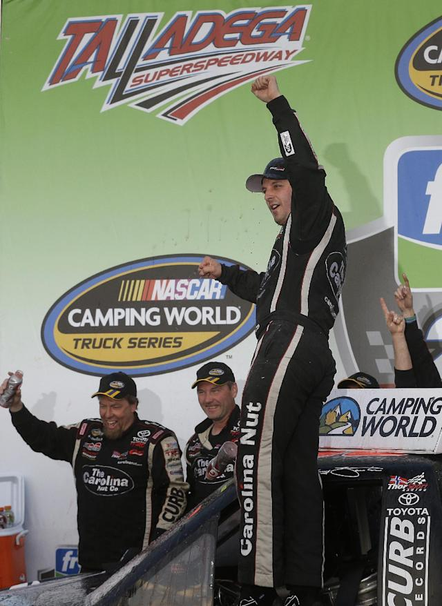 Driver Johnny Sauter celebrates in Victory Lane after winning the NASCAR Camping World Truck Series auto race at the Talladega Superspeedway in Talladega, Ala., Saturday, Oct. 19, 2013. (AP Photo/Jay Sailors)