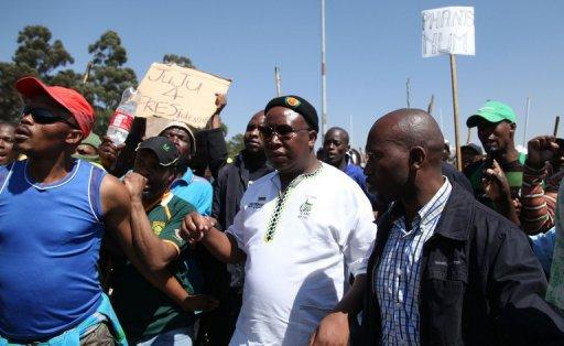 Controversial youth leader Julius Malema (centre), arrives at the Gold Fields Driefontein mine in Carletonville, west of Johannesburg on Tuesday. Hundreds of people barricaded roads leading to a mine of the world's top platinum producer Anglo American on Wednesday as labour unrest spread in South Africa's key industry, police said