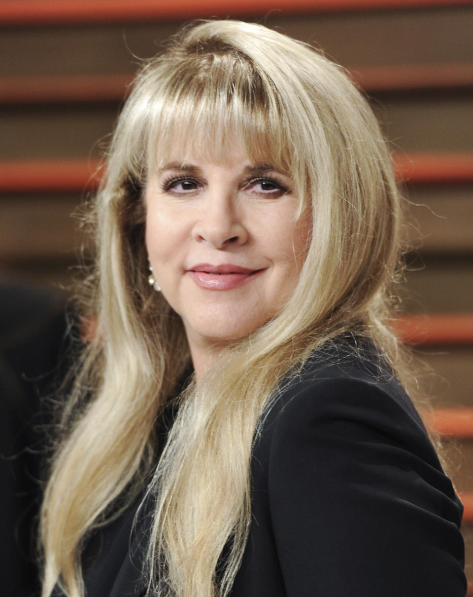 """FILE - Singer Stevie Nicks attends the 2014 Vanity Fair Oscar Party in West Hollywood, Calif., on March 2, 2014, Nicks has spent the last 10 months homebound, mainly due to the coronavirus pandemic. During that time, she recorded the new single """"Show Them the Way"""" and edited her new concert film """"Stevie Nicks 24 Karat Gold The Concert."""" The song will be released Friday and the concert film, recorded over two nights during Nicks' 2016-17 """"24 Karat Gold"""" tour, will be available at select theaters and drive-ins on Oct. 21 and 25. (Photo by Evan Agostini/Invision/AP, File)"""