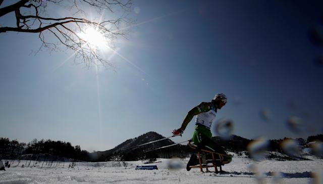 Cross-Country Skiing - Pyeongchang 2018 Winter Paralympics - Men's 15 KM - Sitting - Alpensia Biathlon Centre - Pyeongchang, South Korea - March 11, 2018 - Yauheni Lukyanenka of Belarus competes. REUTERS/Carl Recine