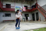 The future first lady of Peru, Lilia Paredes, 48, sweeps the courtyard of her adobe house in the rural hamlet of Chugur, Peru, Thursday, July 22, 2021. Her husband, leftist Pedro Castillo catapulted from unknown to president-elect with the support of the country's poor and rural citizens, many of whom identify with the struggles the teacher has faced. (AP Photo/Franklin Briceno)