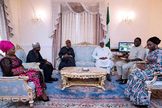 Buhari (third from right) flanked by his aides, in photo taken on August 12 in London (AFP Photo/BAYO OMOBORIOWO)
