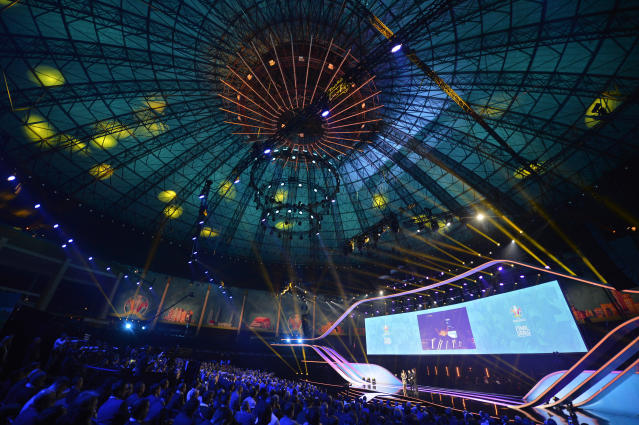 Presenters come on the stage to start the draw for the UEFA Euro 2020 soccer tournament finals in Bucharest, Romania, Saturday, Nov. 30, 2019. (AP Photo/Andreea Alexandru)