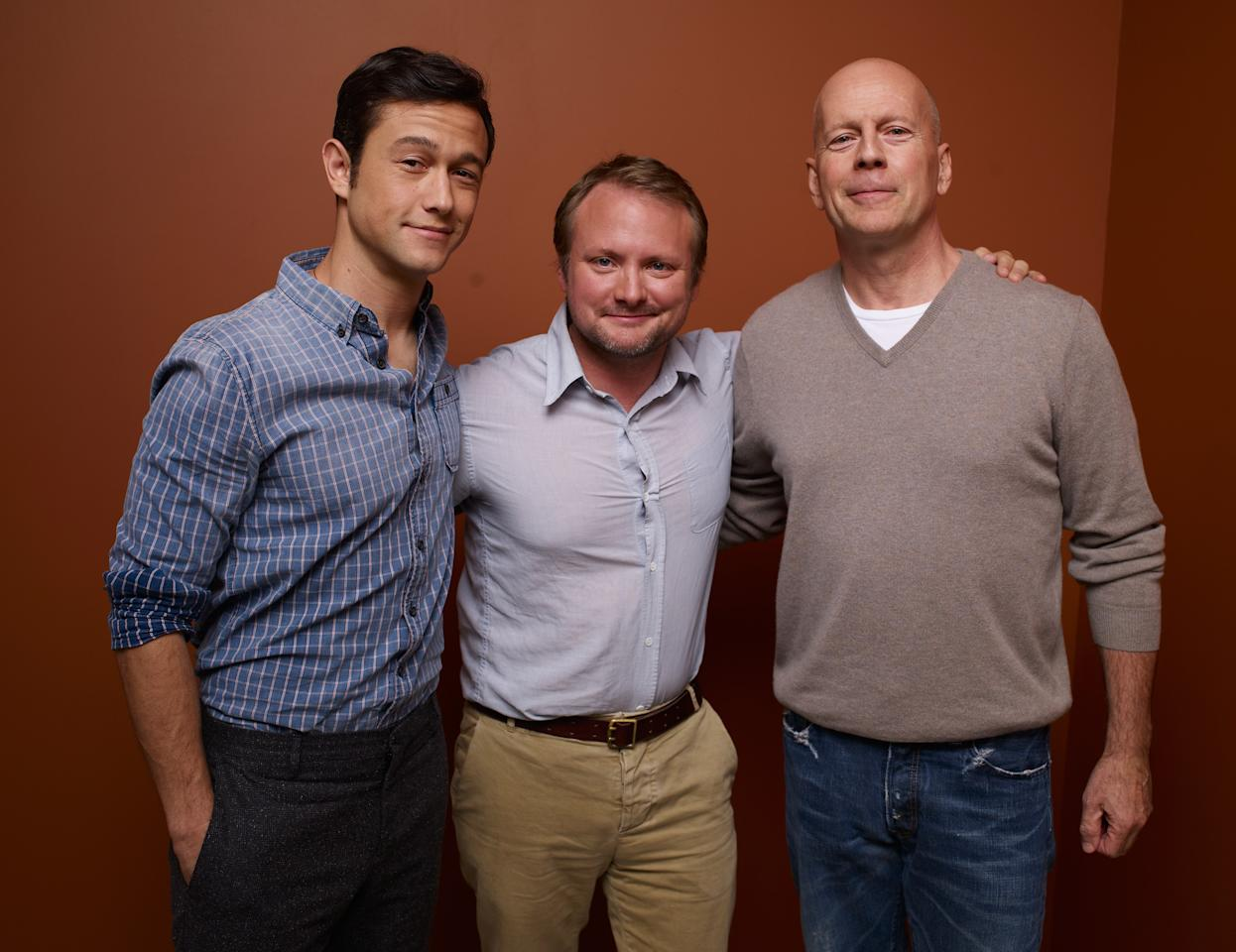 "TORONTO, ON - SEPTEMBER 06:  (L-R) Actor/Producer Joseph Gordon-Levitt, Writer/Director Rian Johnson and actor Bruce Willis of ""Looper"" pose at the Guess Portrait Studio during 2012 Toronto International Film Festival on September 6, 2012 in Toronto, Canada.  (Photo by Matt Carr/Getty Images)"