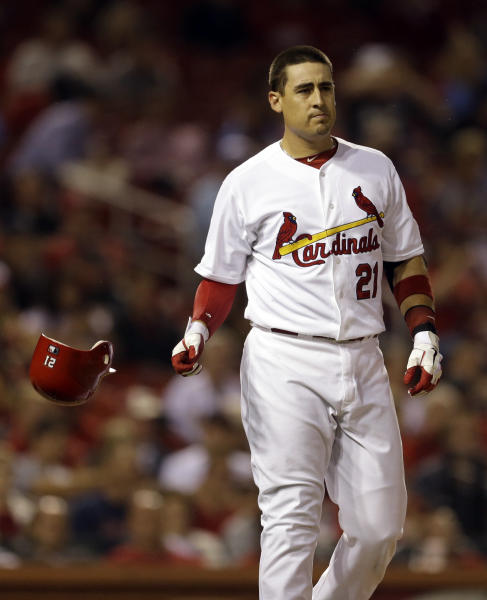 St. Louis Cardinals' Allen Craig drops his helmet after he was called out on strikes to end the third inning of a baseball game against the Milwaukee Brewers, Friday, Sept. 7, 2012, in St. Louis. (AP Photo/Jeff Roberson)
