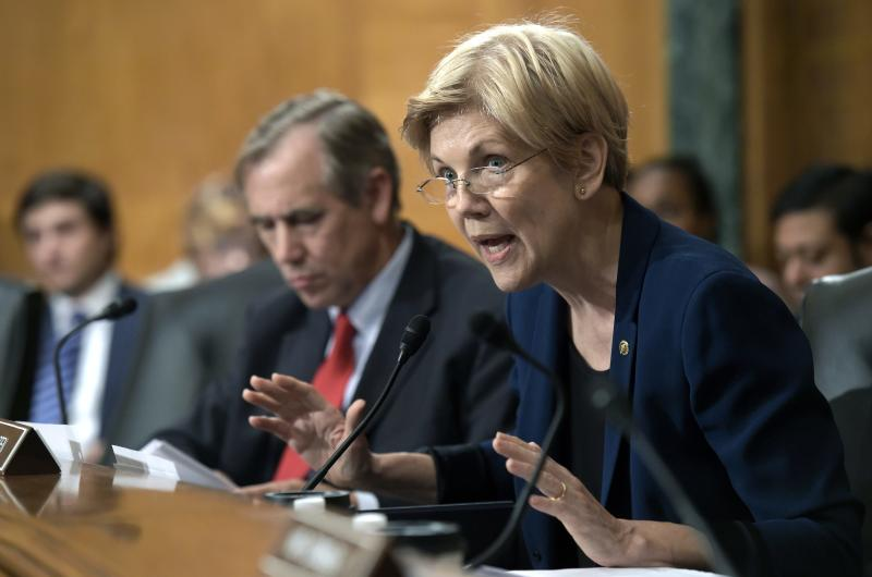 FILE- In this Sept. 20, 2016, file photo, Senate Banking Committee member Sen. Elizabeth Warren, D-Mass., questions Wells Fargo Chief Executive Officer John Stumpf on Capitol Hill in Washington. Warren is leading a new effort to make sure vendors working with marijuana businesses don't have their banking services taken away. (AP Photo/Susan Walsh, File)