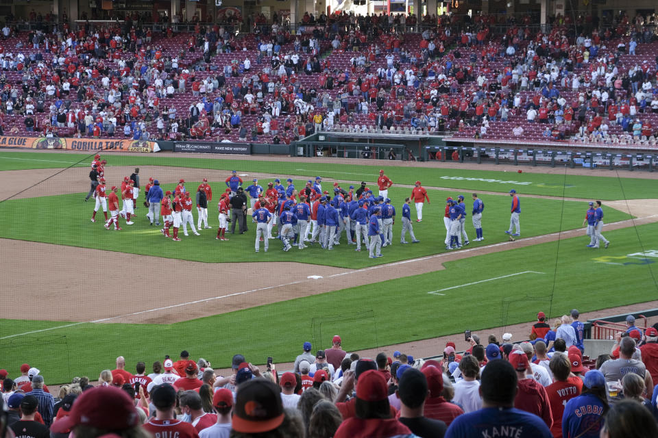 Players from both teams come onto the field in the eighth inning during a baseball game between the Chicago Cubs and the Cincinnati Reds in Cincinnati on Saturday, May 1, 2021. (AP Photo/Jeff Dean)
