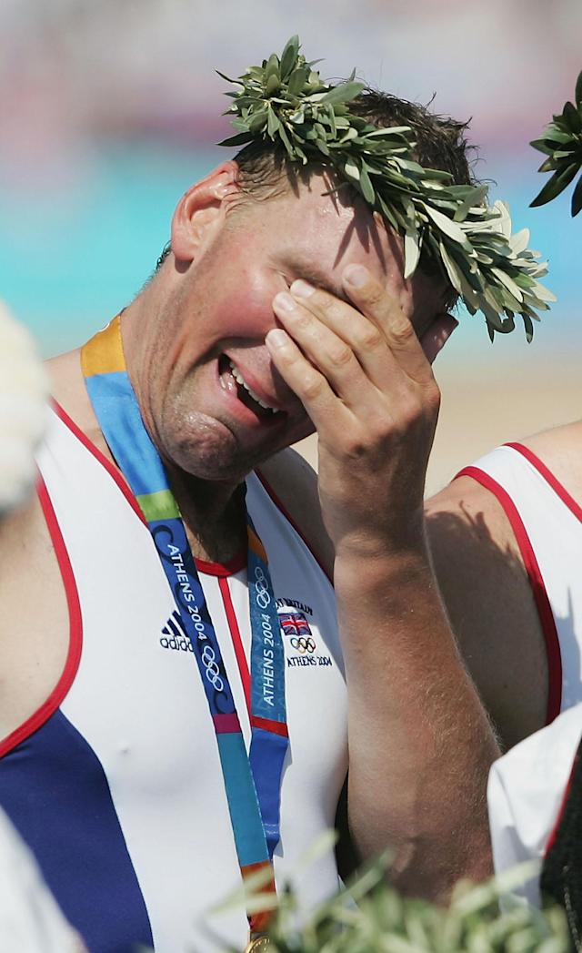 ATHENS - AUGUST 21: A tearful Matthew Pinsent of Great Britain stands on the podium during the medal ceremony for the men's four event on August 21, 2004 during the Athens 2004 Summer Olympic Games at the Schinias Olympic Rowing and Canoeing Centre in Athens, Greece. (Photo by Shaun Botterill/Getty Images)