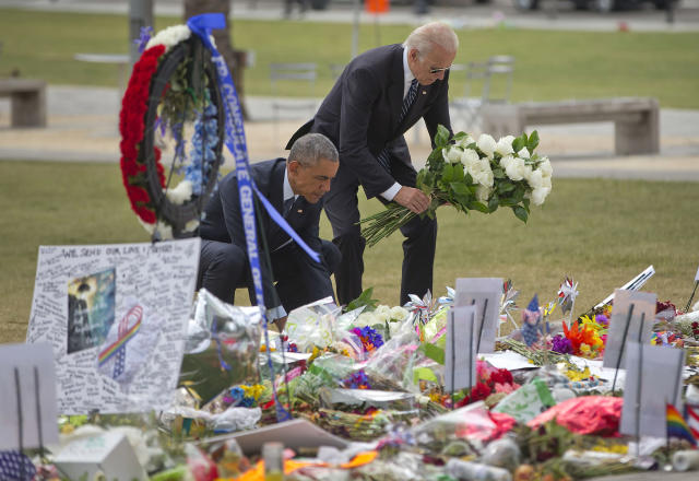 <p>President Obama and Vice President Biden leave flowers at a memorial to the victims of the Pulse nightclub shooting, June 16, 2016, in Orlando, Fla. (AP/Pablo Martinez Monsivais) </p>