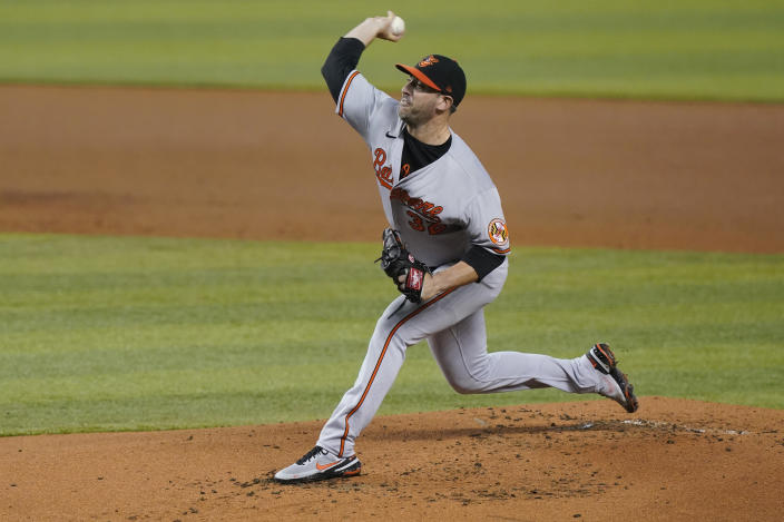 Baltimore Orioles starting pitcher Matt Harvey (32) throws a pitch during the first inning of a baseball game against the Miami Marlins, Tuesday, April 20, 2021, in Miami. (AP Photo/Marta Lavandier)