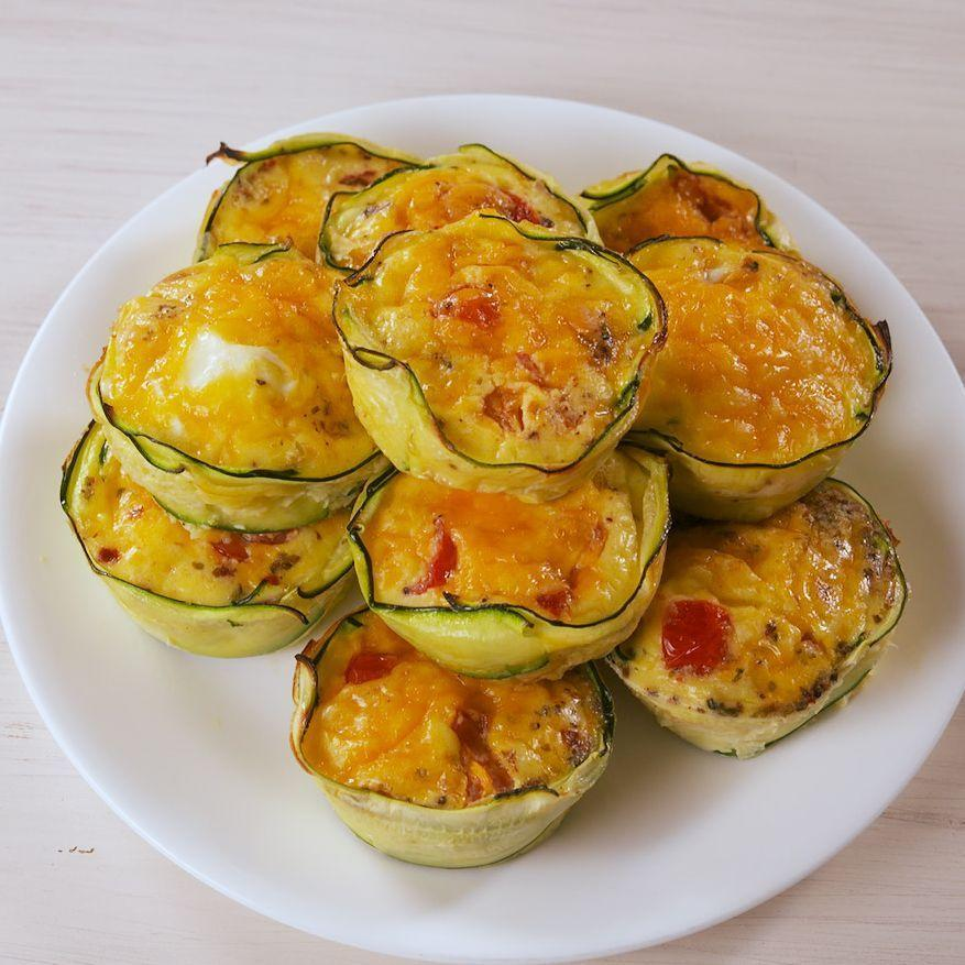 """<p>You ain't seen muffin yet.</p><p>Get the <a href=""""https://www.delish.com/uk/cooking/recipes/a31234265/zucchini-egg-cups-recipe/"""" rel=""""nofollow noopener"""" target=""""_blank"""" data-ylk=""""slk:Courgette Egg Cups"""" class=""""link rapid-noclick-resp"""">Courgette Egg Cups</a> recipe.</p>"""