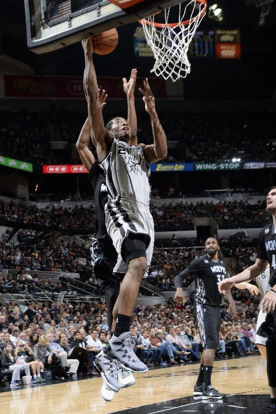 SAN ANTONIO, TX - January 12: Kawhi Leonard #2 of the San Antonio Spurs drives to the basket against the Minnesota Timberwolves at the AT&T Center on January 12, 2014 in San Antonio, Texas