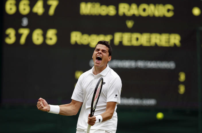 <p>Milos Raonic of Canada celebrates after beating Roger Federer of Switzerland in their men's semifinal singles match on day twelve of the Wimbledon Tennis Championships in London, July 8, 2016. (Photo: Alastair Grant/AP) </p>