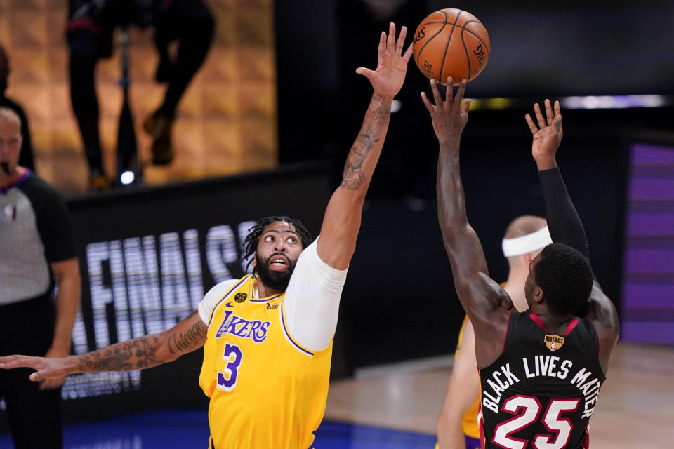 Miami Heat guard Kendrick Nunn, right, shoots over Los Angeles Lakers forward Anthony Davis during the first half in Game 4 of basketball's NBA Finals Tuesday, Oct. 6, 2020, in Lake Buena Vista, Fla. (AP Photo/Mark J. Terrill)