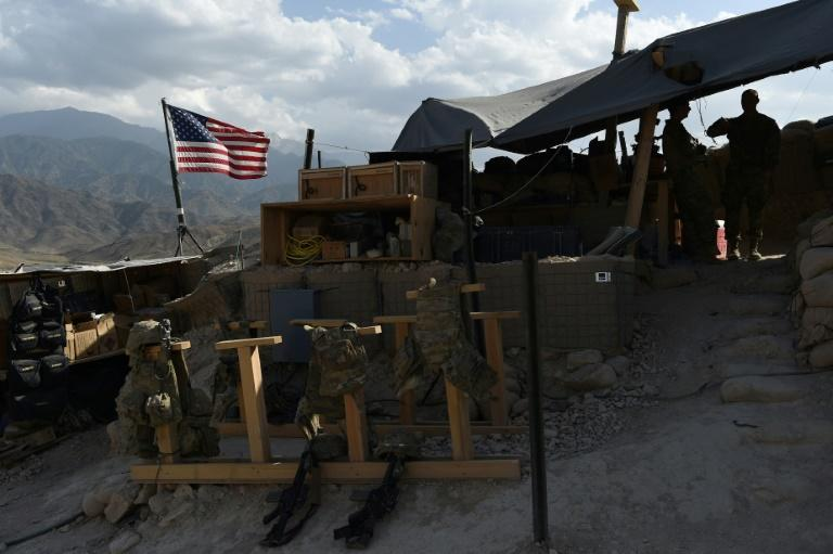 Soldiers look on as a US flag flies at a checkpoint during a patrol against Islamic State militants at the Deh Bala district in the eastern Afghan province of Nangarhar (AFP Photo/WAKIL KOHSAR)