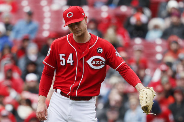 Cincinnati Reds starting pitcher Sonny Gray reacts after giving up a run after walking Pittsburgh Pirates' Trevor Williams with the bases loaded in the third inning of a baseball game, Sunday, March 31, 2019, in Cincinnati. (AP Photo/John Minchillo)