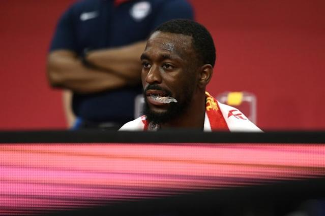 A dejected Kemba Walker looks on during Team USA's losing effort in the Basketball World Cup quarter-final against France (AFP Photo/Ye Aung Thu )