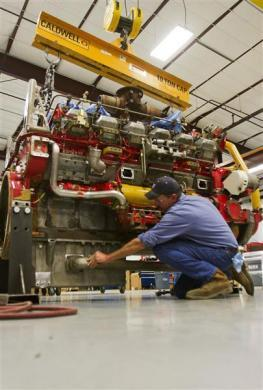 Mechanic Mike Huser works on a CAT 3512 engine used to power hydraulic fracturing pumps at Holt Caterpillar, the largest Caterpillar dealer in the United States in San Antonio, Texas March 19, 2012.