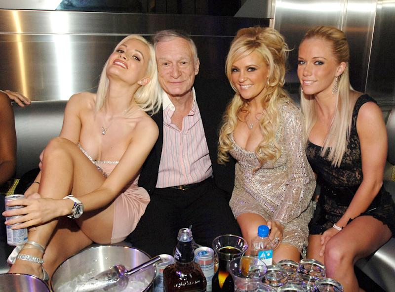"Holly Madison, Hugh Hefner, Bridget Marquardt and Kendra Wilkinson. The reality series ""The Girls Next Door"" followed Hefner's relationships with the three women."