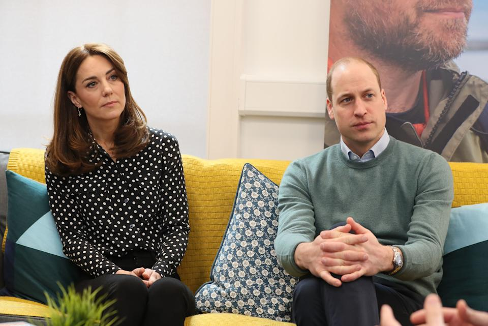 Britain's Prince William (R), Duke of Cambridge, and Britain's Catherine (L), Duchess of Cambridge, talk with campaigners, teachers parents of young people who've been supported and coaches during a visit Jigsaw, the National Centre for Youth Mental Health, in Dublin on March 4, 2020 on the second day of their three day visit. (Photo by Brian Lawless / POOL / AFP) (Photo by BRIAN LAWLESS/POOL/AFP via Getty Images)