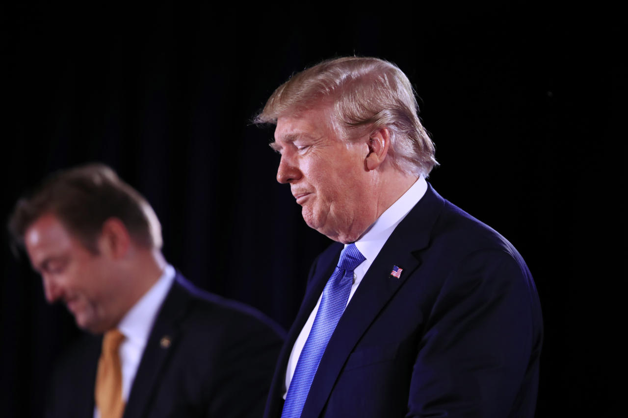 President Donald Trump with Sen. Dean Heller, R-Nev., speaks at a Nevada GOP Convention in Suncoast Hotel and Casino in Las Vegas, Saturday, June 23, 2018. (AP Photo/Manuel Balce Ceneta)