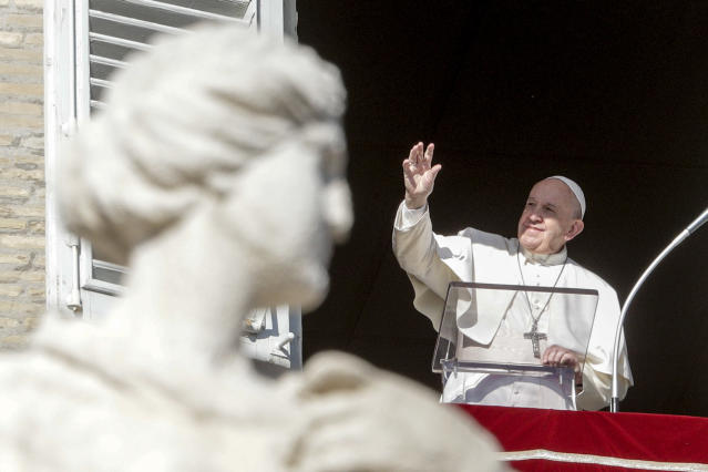 Pope Francis delivers his blessing as he recites the Angelus noon prayer from the window of his studio overlooking St.Peter's Square, at the Vatican, Thursday, Dec. 26, 2019. (AP Photo/Andrew Medichini)