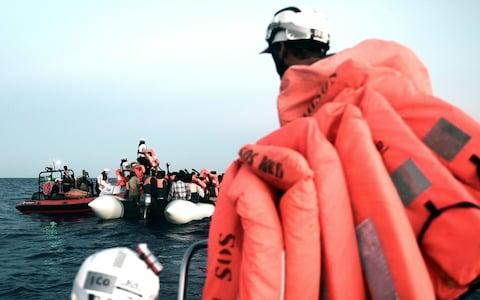 Migrants are rescued by crew from the MV Aquarius, a search and rescue ship run in partnership between SOS Mediterranee and Medecins Sans Frontieres, in the central Mediterranean Sea, June 9, 2018. - Credit: Karpov/Reuters