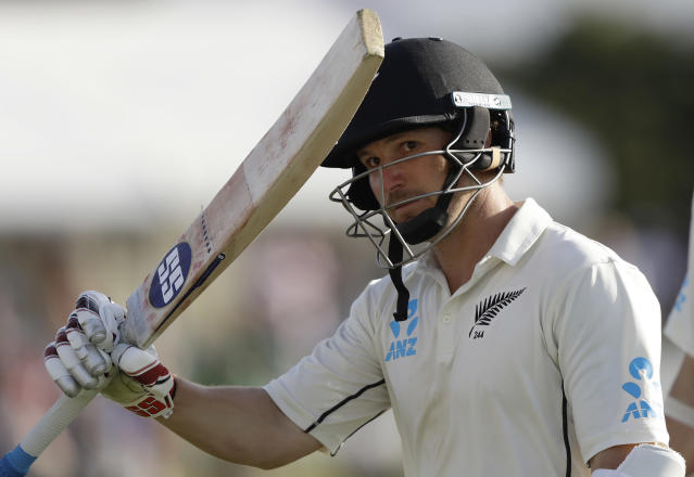 New Zealand's BJ Watling waves his bat to the crowd as he leaves the field 119 not out at the close of play on day three of the first cricket test between England and New Zealand at Bay Oval in Mount Maunganui, New Zealand, Saturday, Nov. 23, 2019. (AP Photo/Mark Baker)