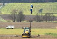Workers service a local power line at the town of Guessing, where just 25 years ago was one of the poorest in Austria (AFP Photo/Joe Klamar)