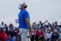 Team Europe's Tyrrell Hatton reacts after missing a putt on the 15th hole during a four-ball match the Ryder Cup at the Whistling Straits Golf Course Friday, Sept. 24, 2021, in Sheboygan, Wis. (AP Photo/Jeff Roberson)