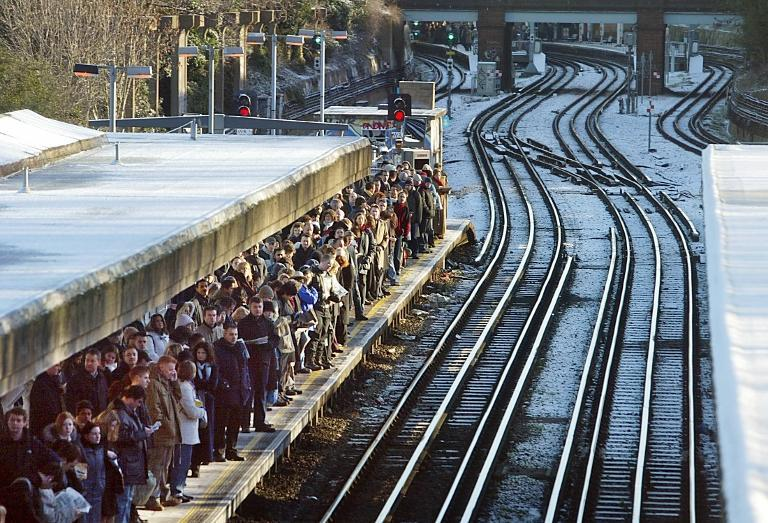 Rail commuters pack the platform at Northfields station in west London