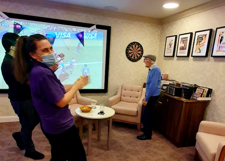 Staff at the care home put on regular quizzes, cocktail nights and screens live sports on a giant TV for residents. (SWNS)