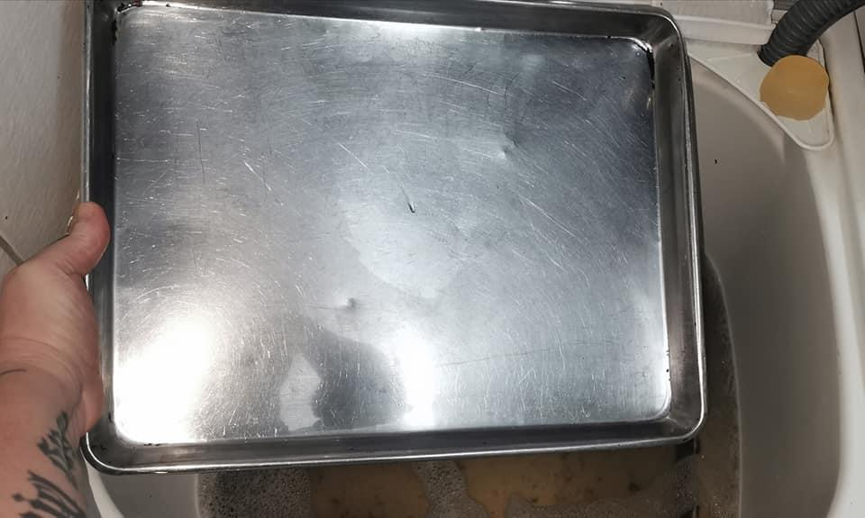 AFTER: the baking tray was squeaky clean after a soak in Aldi's Di San Oxy Laundry Soaker. Photo: Facebook.