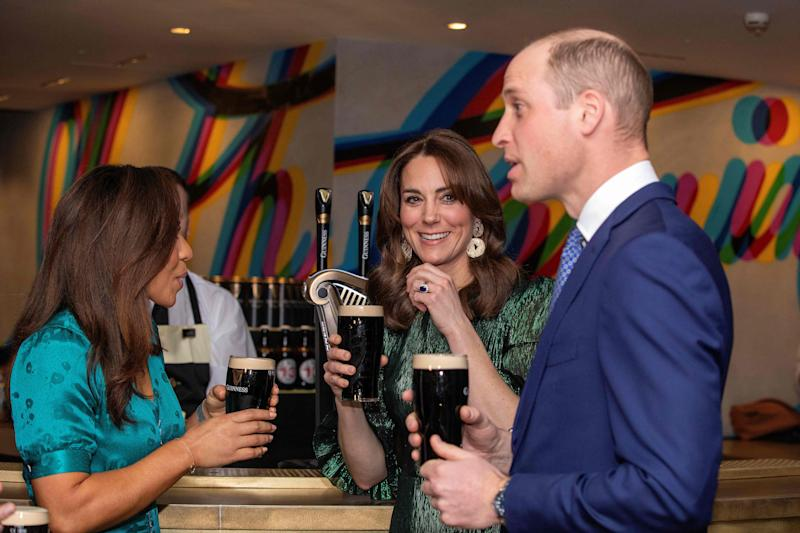 Britain's Prince William, Duke of Cambridge, and Catherine, Duchess of Cambridge, hold pints of Guinness as they attend a special reception at the Guinness Storehouses Gravity Bar in Dublin on March 3, 2020 on the first day of their Royal Highnesses three-day visit. (Photo by PAUL FAITH / various sources / AFP) (Photo by PAUL FAITH/AFP via Getty Images)