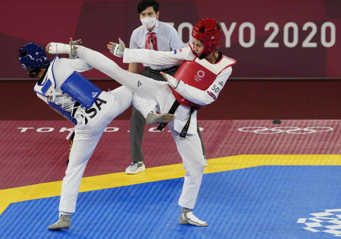 Croatia's Matea Jelic, right, attacks United States' Paige McPherson during the taekwondo women's 67kg match at the 2020 Summer Olympics, Monday, July 26, 2021, in Tokyo, Japan. (AP Photo/Themba Hadebe)